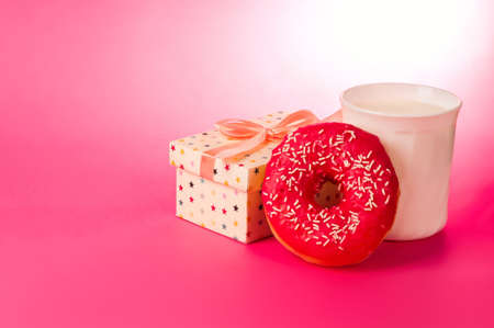 donut with milk on a pink background Stock Photo