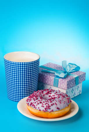 donut with milk on a blue background Stock Photo