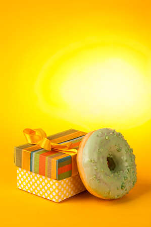 donut and gift on a yellow background