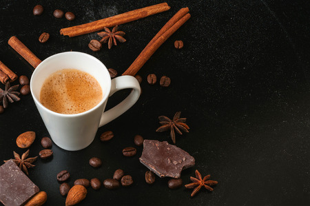 coffee and spices on a black background