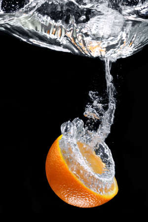 juicy orange with splashes of water Stock Photo