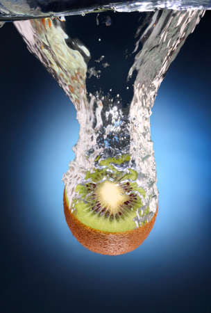 juicy kiwi with splashes of water photo