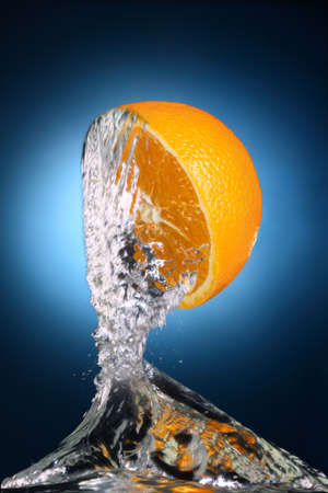 juicy orange with splashes of water Stock Photo