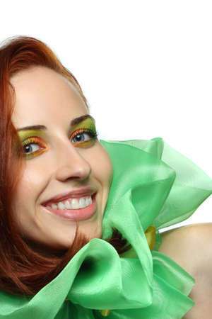 half dressed: red-haired, blue-eyed girl with a beautiful smile