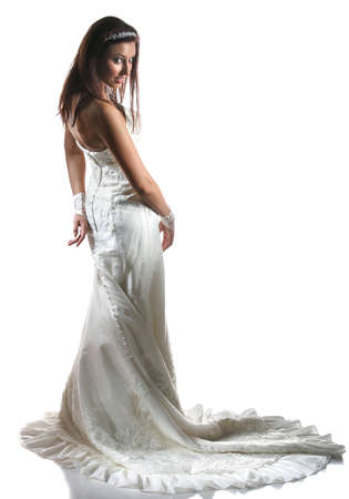 Bride in wedding dress with long train on a white background Stock Photo