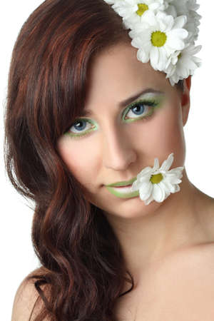 beautiful girl with daisies on white background