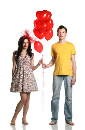 boy and girl with red balloons hearts photo