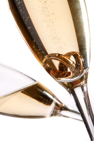 wedding rings in a glass of champagne photo