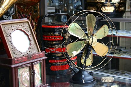 reminisce: old antique fan Stock Photo