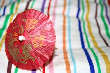 red paper umbrella on striped cotton Stock Photo - 1557361