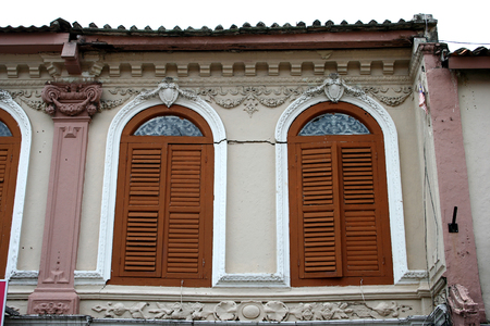 old vintage wooden windows on shop houses in asia photo