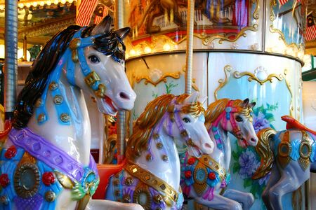 fair play: candy colored carousel horses Stock Photo