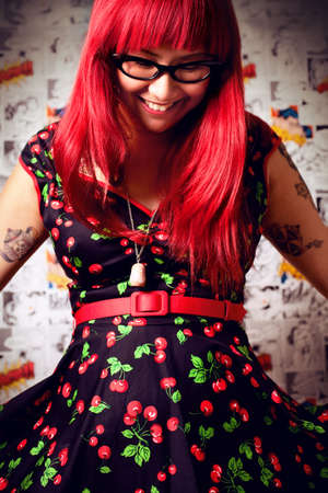 Woman in a cherry dress. photo
