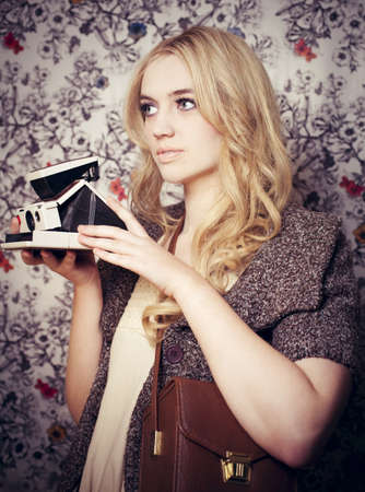 Girl holding old fashion camera. Stock Photo - 8817206