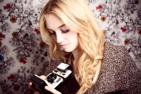 Beautiful woman with camera photo