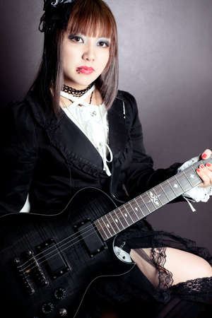 Gothic girl and her guitar photo