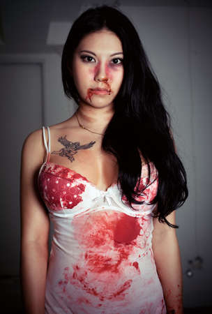 Young victim cover with blood. Stock Photo
