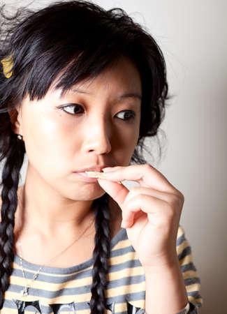 Close up shoot. Girl eating food. Stock Photo - 9240420