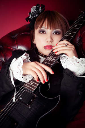 The gothic girl and her dark guitar photo