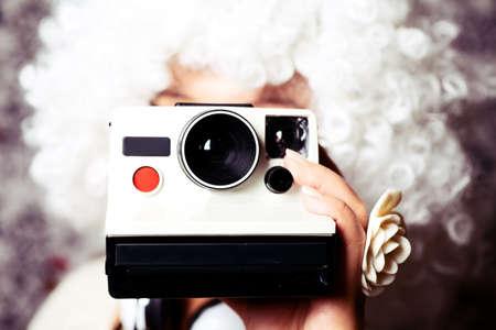 Girl holding camera. Stock Photo - 9436678