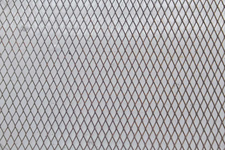 chained link fence: Wired fence pattern on a gray background