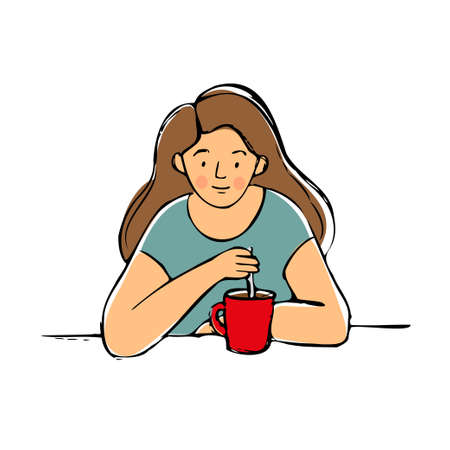 The girl with cup sits at the table . The woman is drinking tea or coffee.