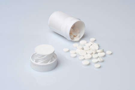 birth control pill: Pills spilling from a bottle
