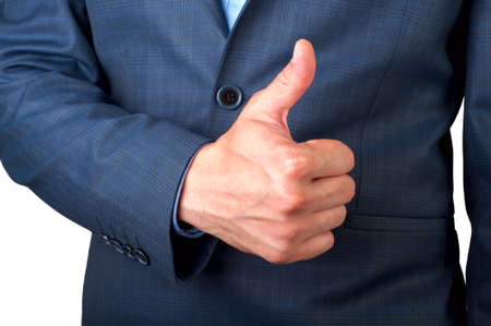 satisfactory: A man in a suit hand gesturing thumbs up Stock Photo