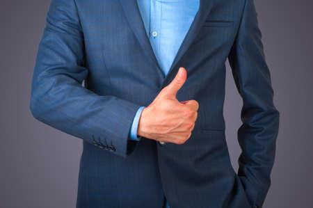 tumb: Detail of a businessman gesturing tumb up Stock Photo