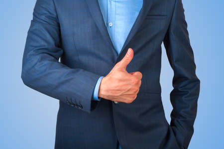 Detail of a businessman gesturing tumb up Stock Photo
