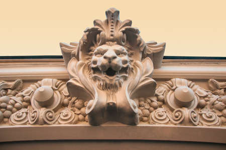 heads old building facade: Lions Head. The decor of the building Stock Photo