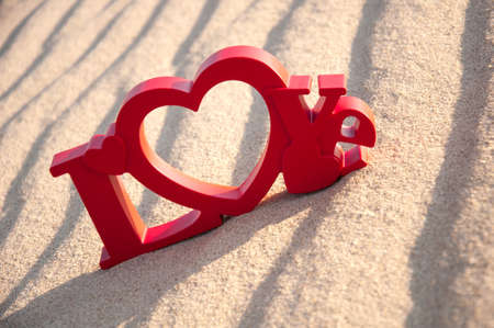 out of engagement: The word love and the sand in the background