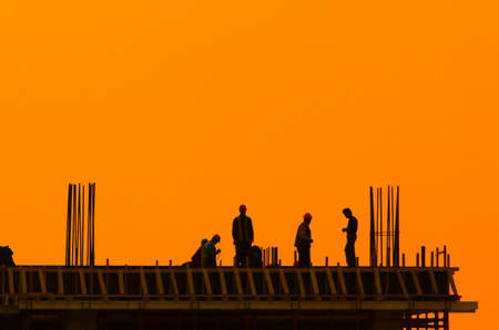 Builders on a construction site for a new building Stock Photo