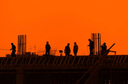 Monolith: Builders on a construction site for a new building Stock Photo