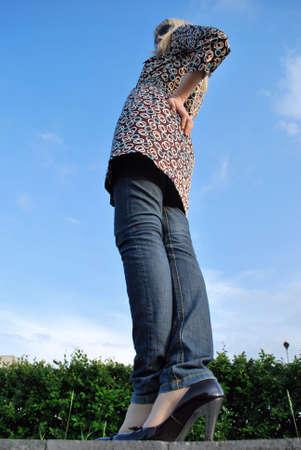 Model woman in dress & jeans Stock Photo