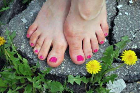 y foots on asphalt islet