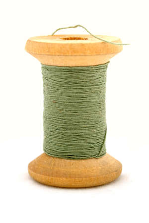 Isolated green spool on white background