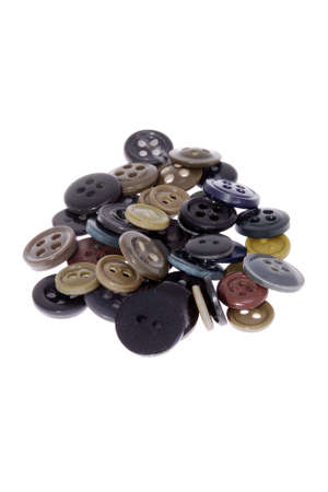 Pile of assorted buttons, isolated on white background Stock Photo
