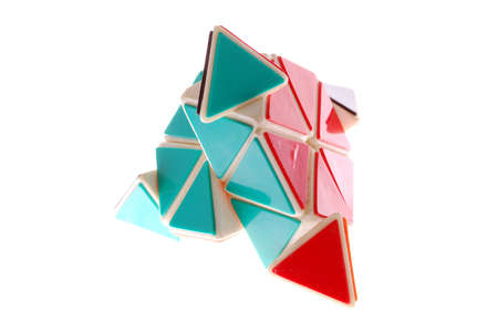 A colorful triangle toy isolated on white