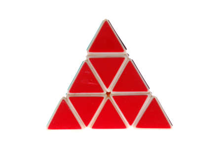 A toy in the shape of a triangle made of red triangles, isolated on a white background