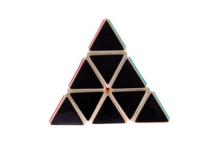 A toy in the shape of a triangle made of black triangles, isolated on a white background