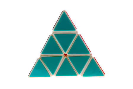 A toy in the shape of a triangle made of green triangles, isolated on a white background