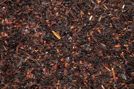 pekoe: Dark loose leaf tea background Stock Photo