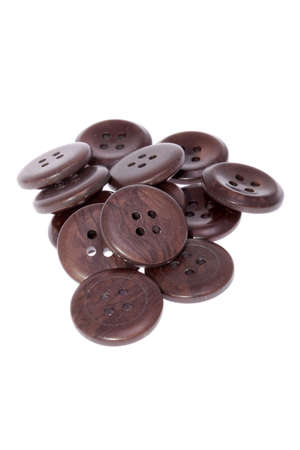 Pile of brown buttons, isolated on white background