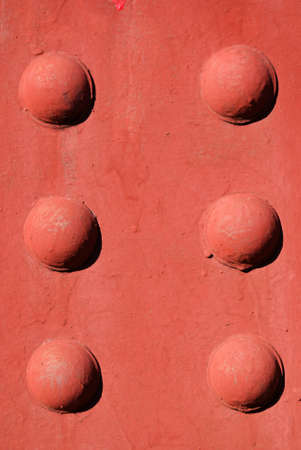 A red background with raised circles. Stock Photo