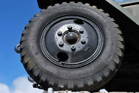 Closeup of a used wheel on a retro automobile. Taken from a low perspective. Stock Photo
