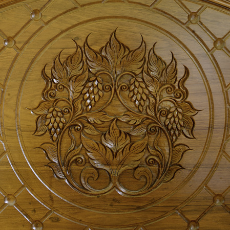 Thai style teak wood engraving Grape photo