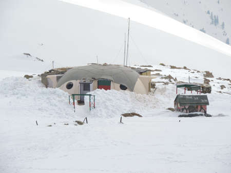 climatic: Military base on high peaks of snow clad mountains in Gulmarg, Kashmir.This place witnesses harsh climatic conditions for most time of the year.