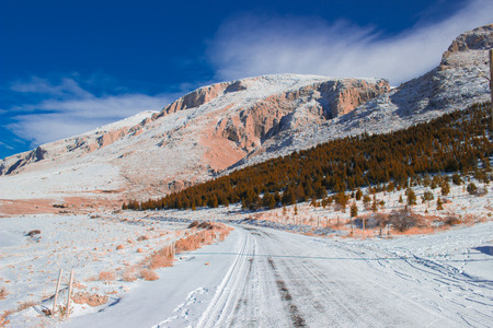 pink mountain snow cold winter sports holiday way trees sky nature Stock Photo