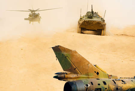 War equipment. Helicopter, fighter jet and tank. Preparation for war in the desert. Foto de archivo